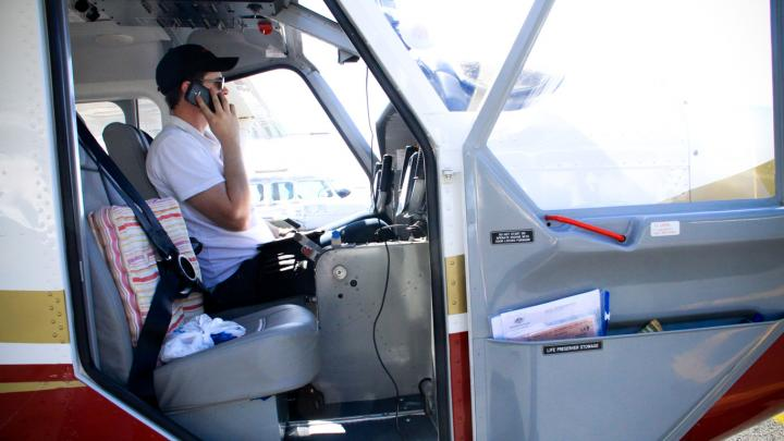 Pilot making a phone call
